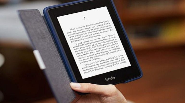 Image of a person holding E-book in his hand