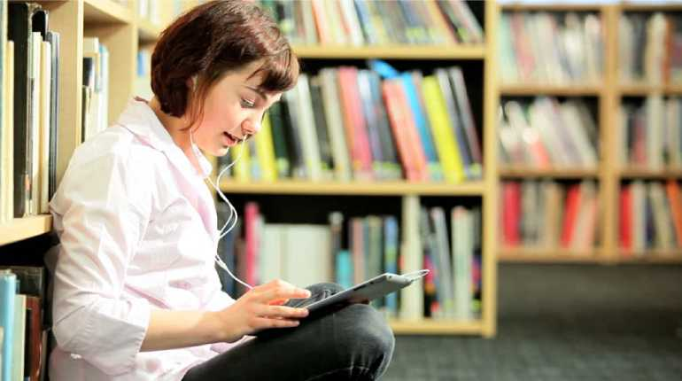 Image of a women reading book in library
