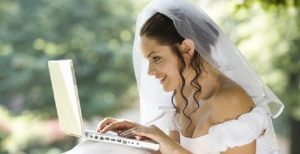 A Happy Bride holding a laptop