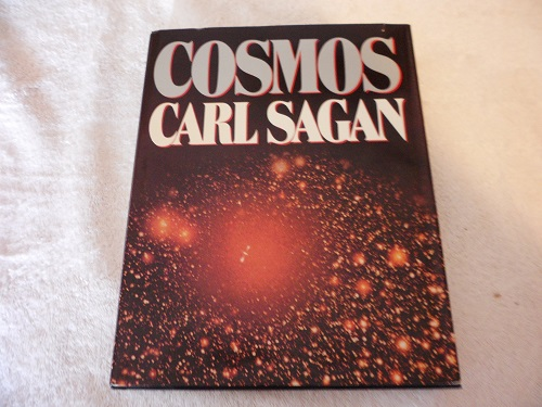 A Book About Cosmos By Carl Sagan.